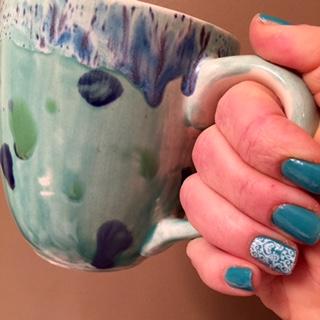 green mug and mani